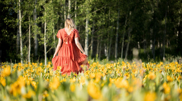 woman walking in wildflowers