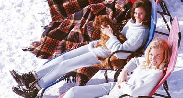 Women relaxing on the snow