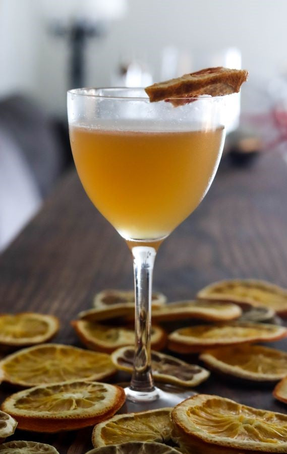 Brown Derby with dehydrated grapefruit garnish in a honeycomb nick and nora cocktail glass from amehla co.