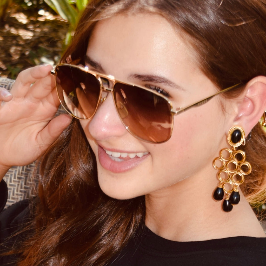 Model wearing Gucci and clip on earrings