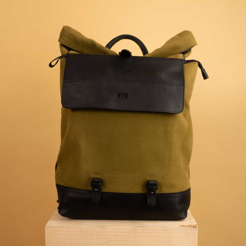 luxury Leather canvas roll top Rucksack with separate laptop compartment and removable front zipper pocket