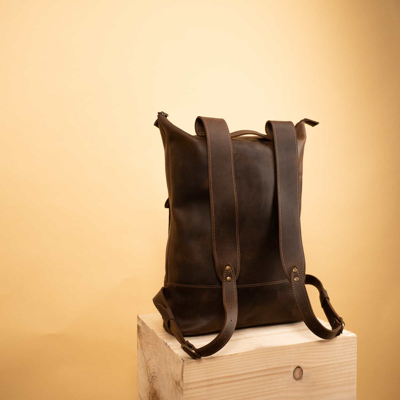 brown Handcrafted leather backpack with one front zipper pocket