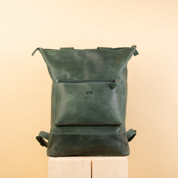 luxury green Handcrafted leather backpack with one front zipper pocket