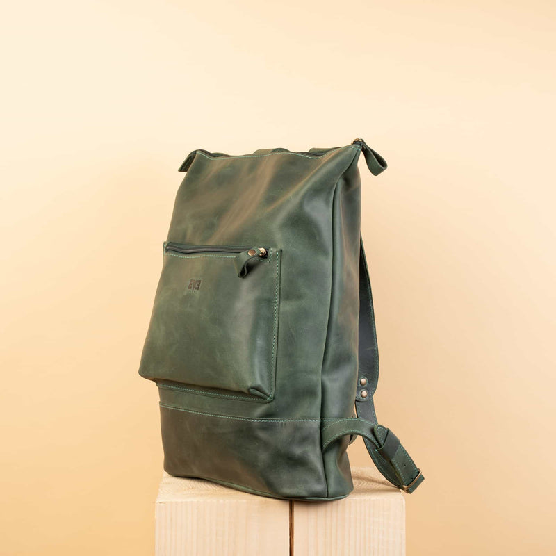 Handcrafted leather backpack with one front zipper pocket