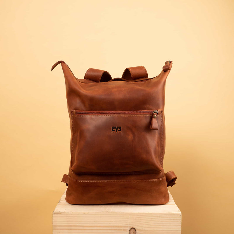 cognac brown Handcrafted leather backpack with one front zipper pocket