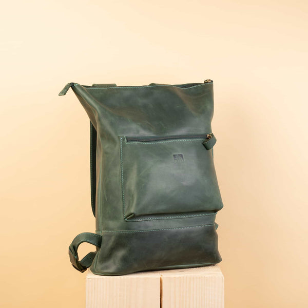 premium green Handcrafted leather backpack with one front zipper pocket
