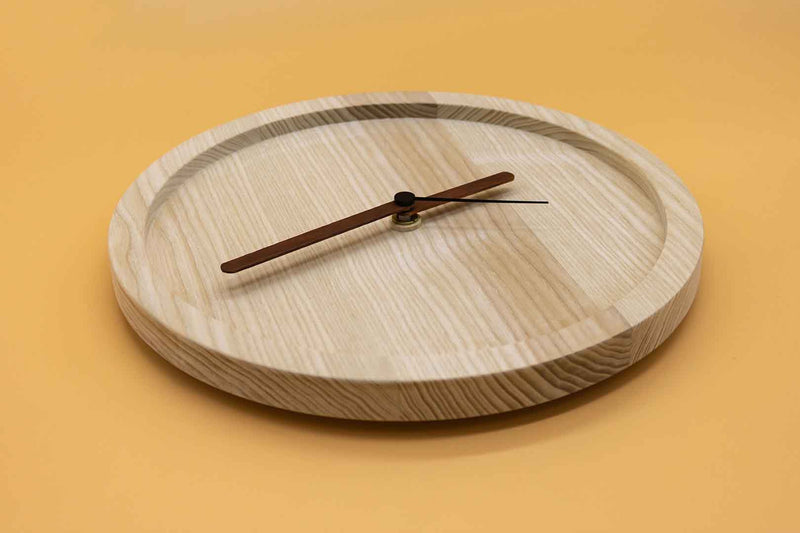 Naked Eora is a design wall clock made of sustainable certified ash wood