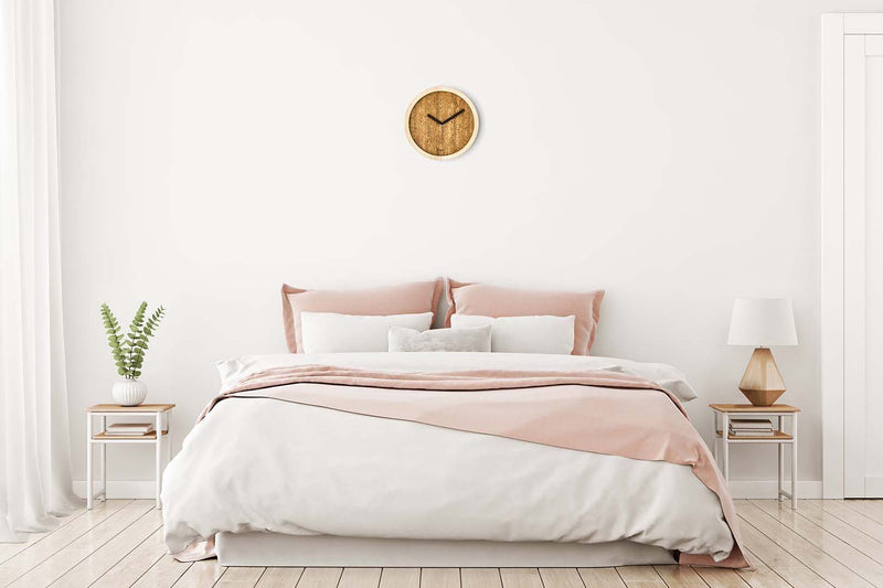 Eora design clock in a bedroom (cork and ash wood)
