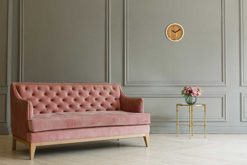 Eora design wall clock in a classical living room (cork and ash wood)