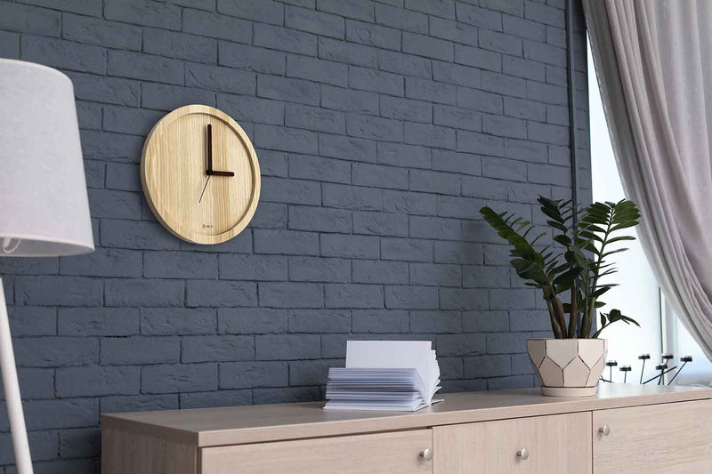 Wooden wall clock in a modern office (ash wood)