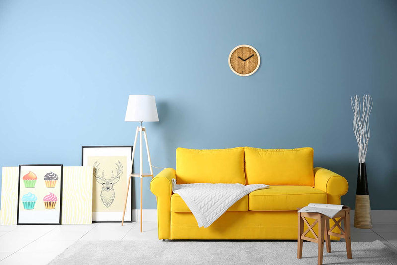 Eora design wall clock in a minimal living room (cork and ash wood)