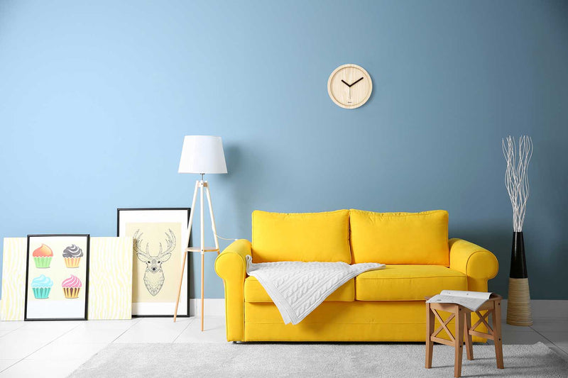 Eora design wall clock in a minimal living room (solid ash wood)