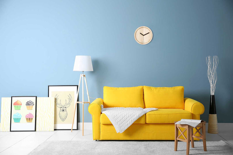 Eora design wall clock in a minimal living room (pure ash wood)
