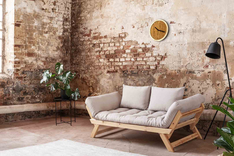 EORA design wall clock on a natural wall (cork and ash wood)