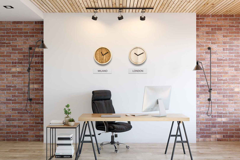 Different time zone in EORA design wall clocks in a office (cork and ash wood)