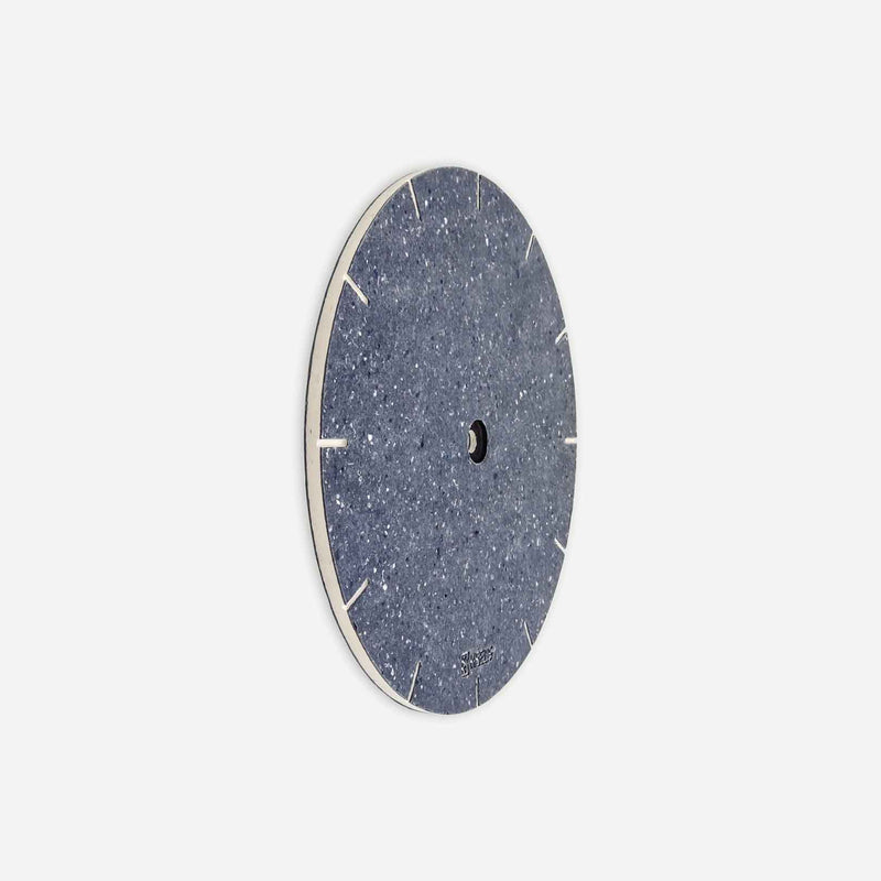 Kibelis Eora's new clock dial is made of Cotton Blue Really, ecofriendly blue material made of upcycled fabric | Side