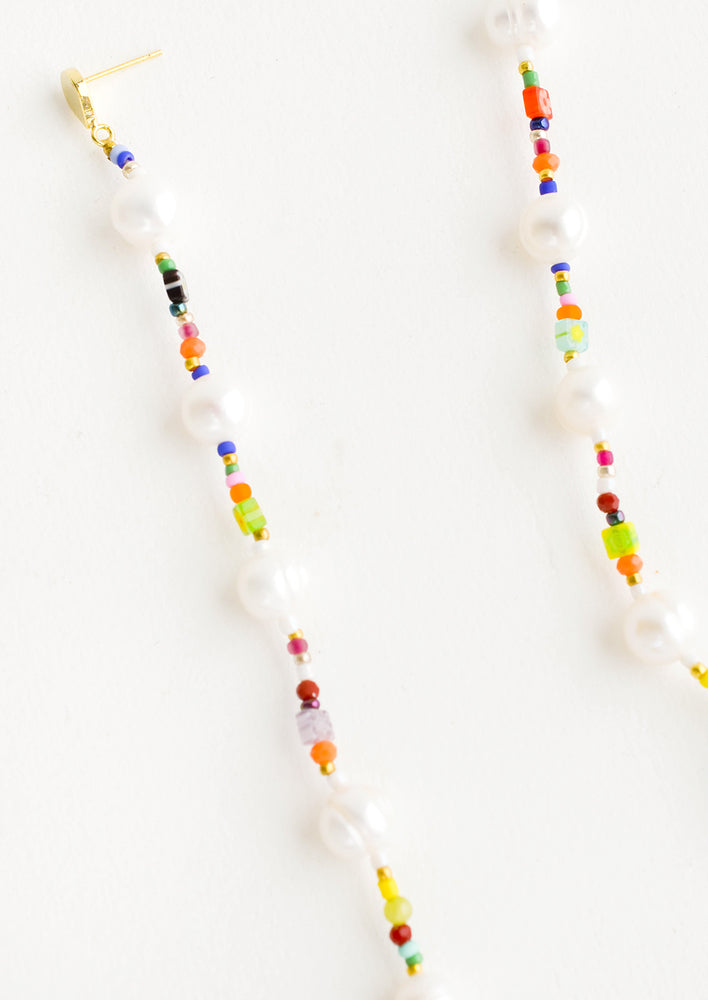1: Earrings comprised of colorful mix of seed beads and freshwater pearls