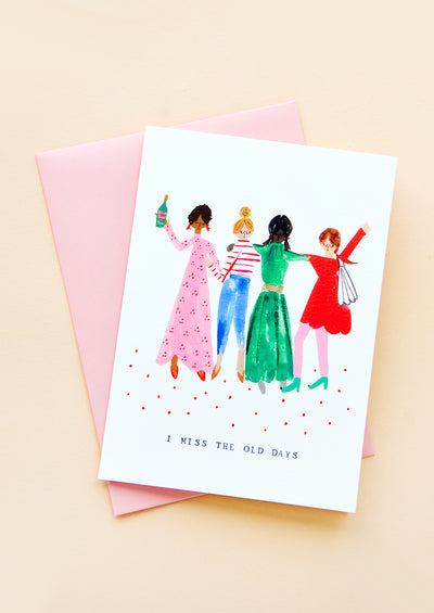 "Greeting card with illustration of four women partying, text at bottom reads ""I Miss The Old Days"". Pink envelope."
