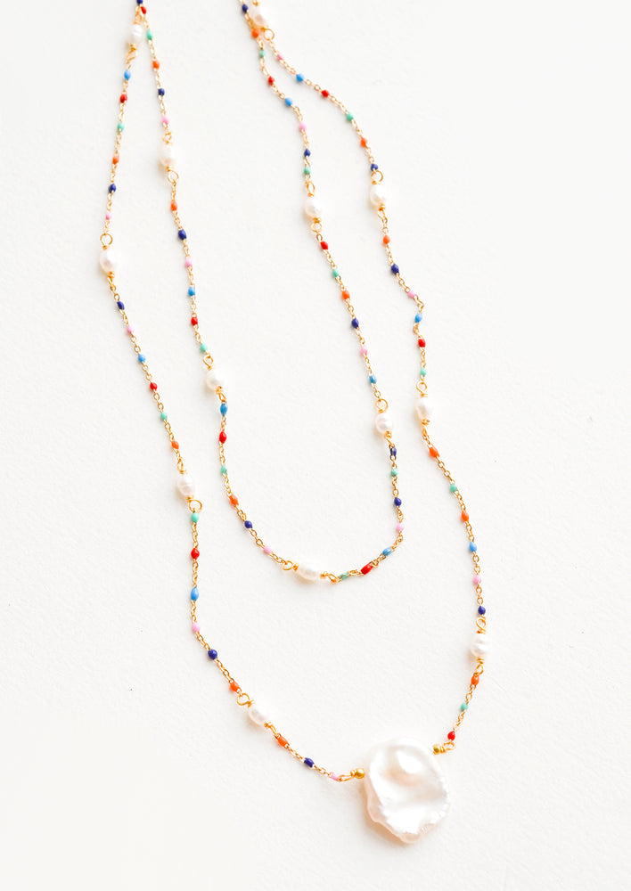 1: Delicate, layered 2-strand necklace with rainbow colored beads on fine gold chain, pearl pendant at center