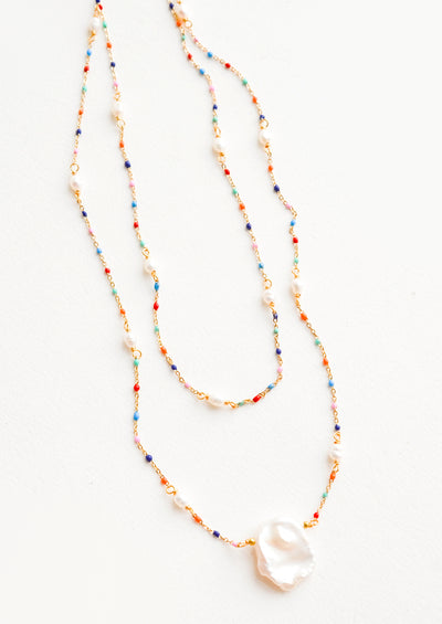 Delicate, layered 2-strand necklace with rainbow colored beads on fine gold chain, pearl pendant at center