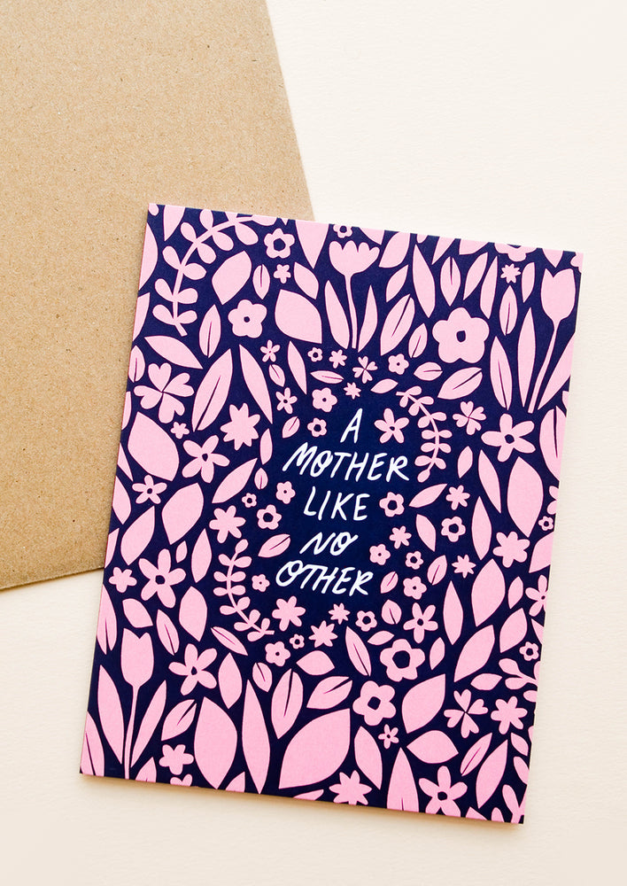 "1: Greeting card with navy blue background and allover pink floral pattern, text in center reads ""A mother like no other"""