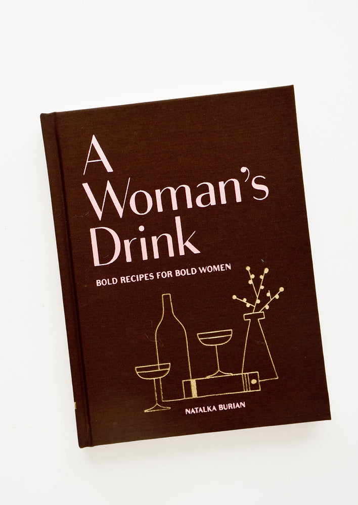 "1: Front of a book with the text ""A Woman's Drink"" and line drawings of cocktails; pink on maroon."