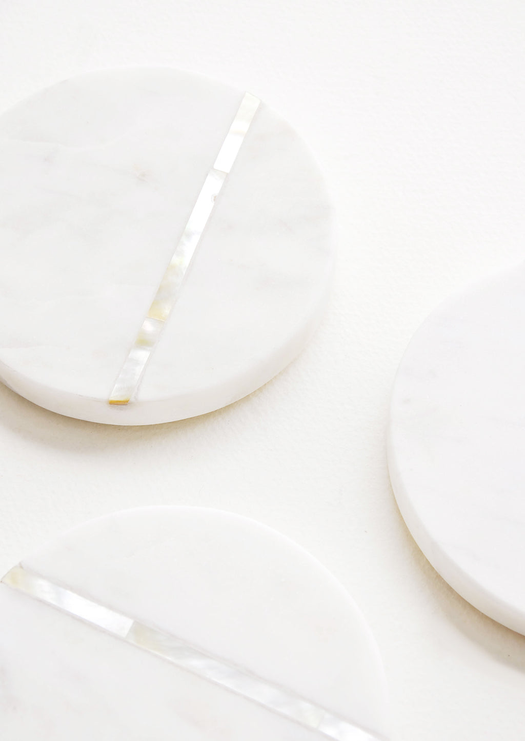 2: Detail of Round White Marble Coasters with Abalone Shell Inlay.