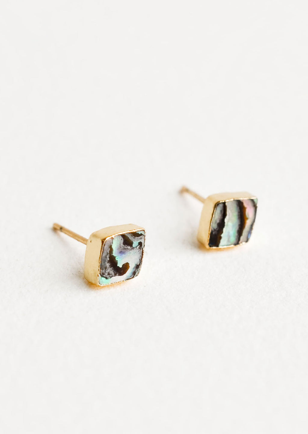 1: Diamond shape stud earrings with flush set stone. Abalone shell surrounded by gold trim.