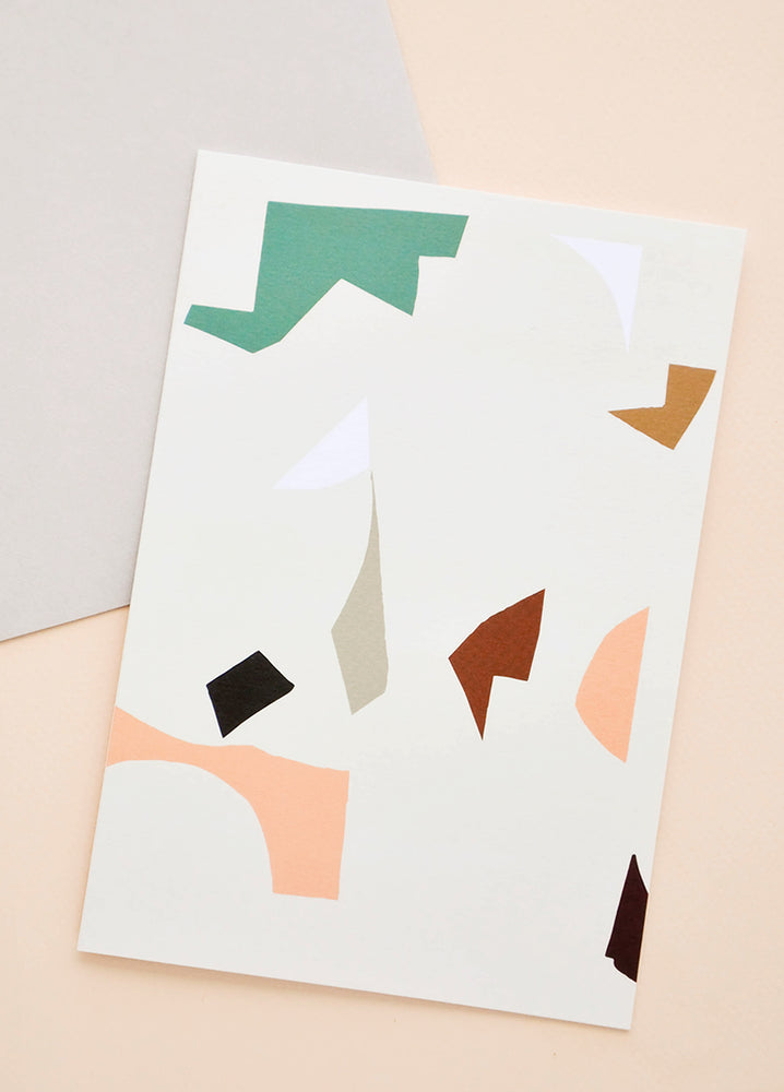 1: Greeting card with colorful abstract shapes. Shown with envelope.