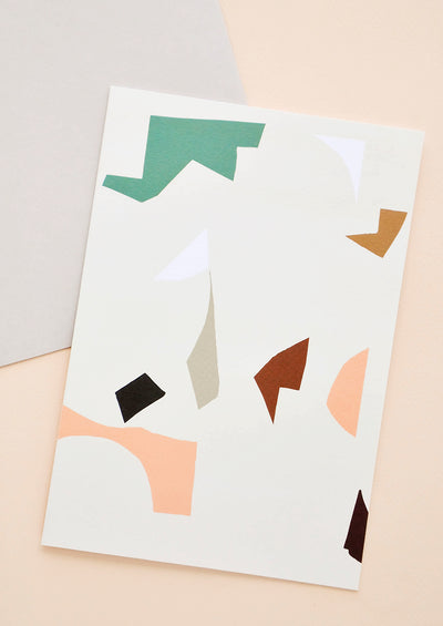 Greeting card with colorful abstract shapes. Shown with envelope.