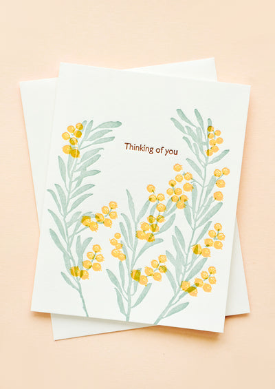 "Greeting card with letter press printed acacia flowers and text reading ""Thinking of you"""