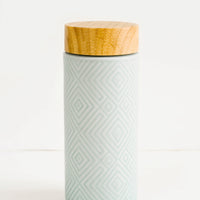Mint Green: Geometric textured ceramic tall travel tumbler in mint color with bamboo lid