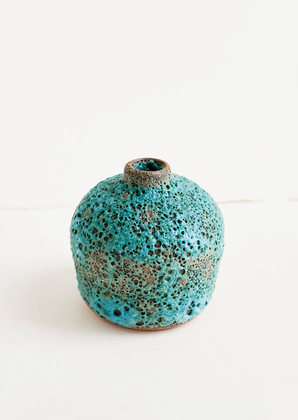 Bud Vase: Short bud vase in heavily textured turquoise glaze