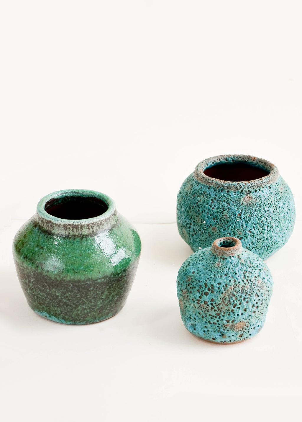 2: Group of three vases in heavily textured turquoise glazes