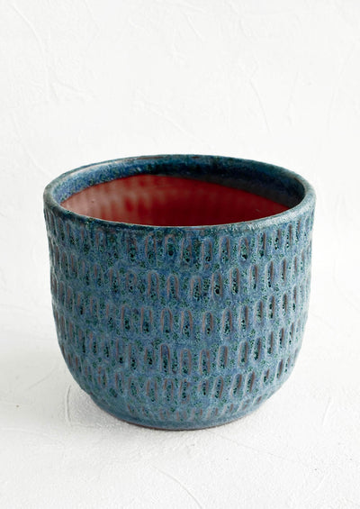 Terracotta planter in textured jewel tone blue glaze with allover line texture