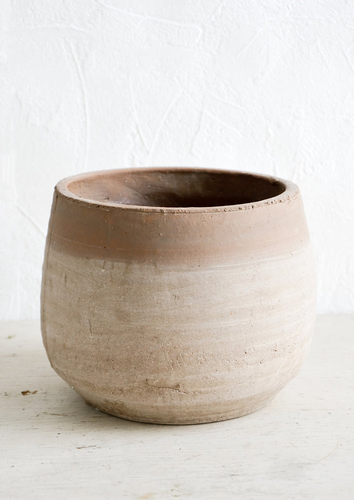 2: Round terracotta planter with distressed, whitewashed look