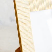 2: Picture frame made from cream colored bone with ribbed texture