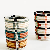 1: Pencil cup shaped baskets woven from multicolor sweetgrass.