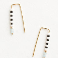 Black / White: Staple shaped earrings in gold metal with stacked glass seed beads on one side in a mix of colors