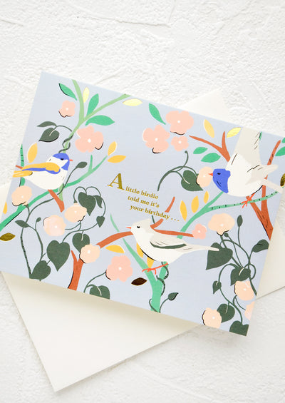 "Greeting card with aviary print and golden text reading ""A little birdie told me it's your birthday"""