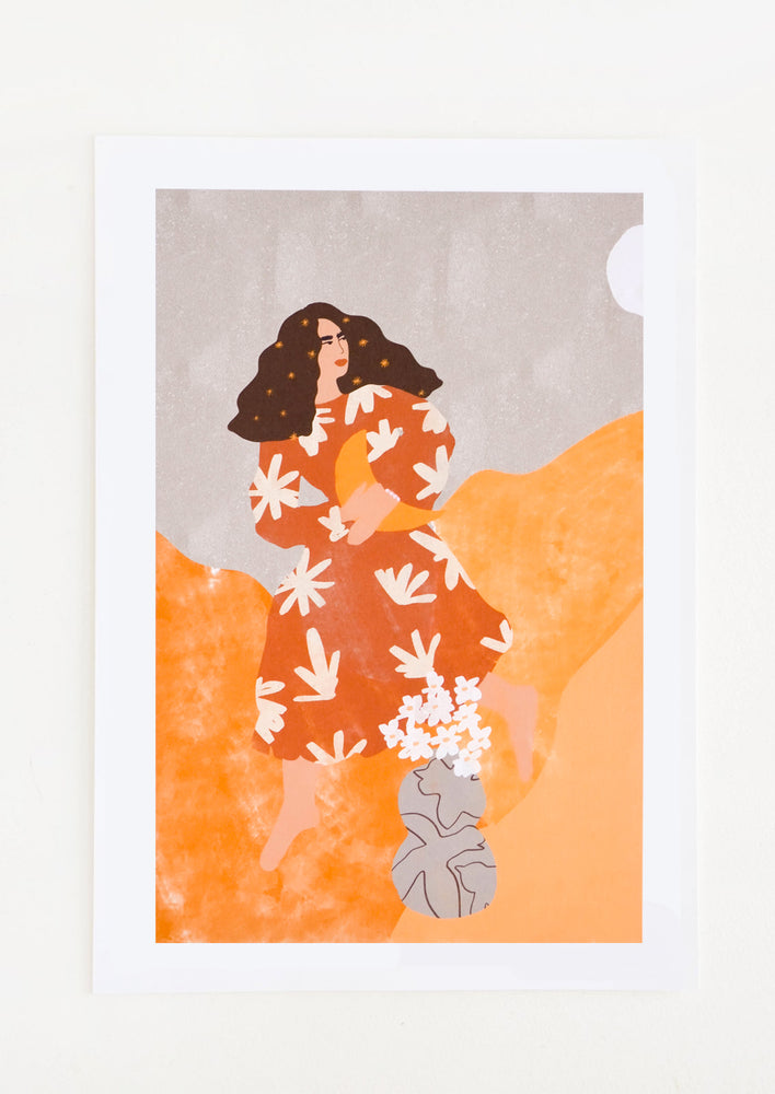1: A long brown-haired woman in a rust colored floral dress holds a crescent moon in her arms as she moves through an orange and gray world.