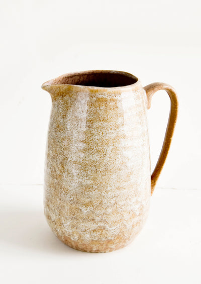 Large ceramic pitcher with handle in reactive glossy brown glaze