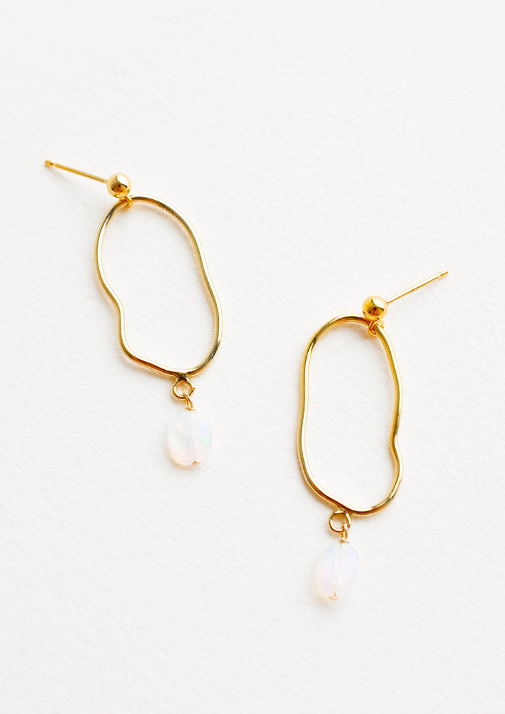 1: Gold imperfectly shaped oval earrings each with a small dangling opal gemstone.