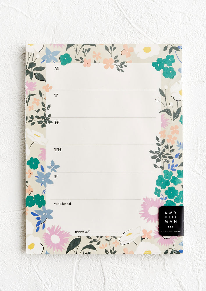 1: A weekly agenda notepad with floral border.