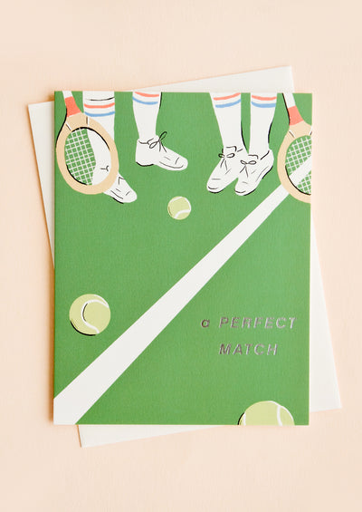 "Greeting card with tennis court vignette, silver text at corner reads ""A perfect match"""