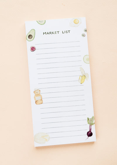 A printed notepad for making grocery lists, illustrated at sides with various food items.