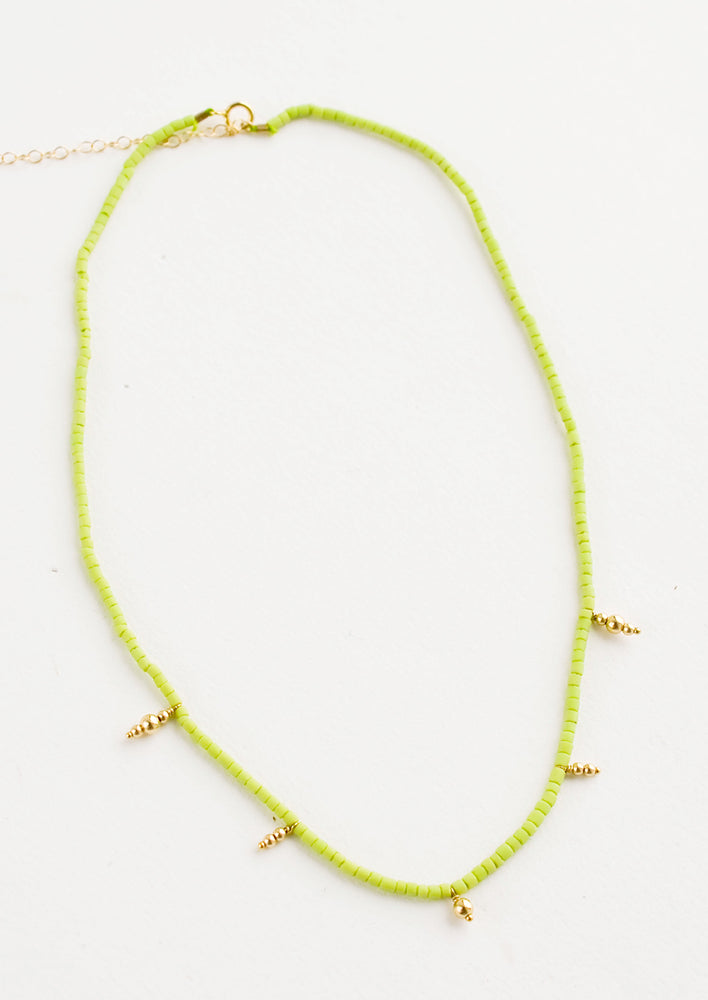 Lime: Beaded necklace with small lime green and gold beads