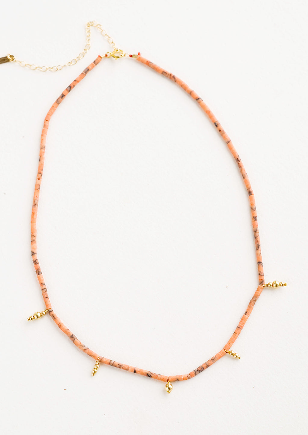 Peach: Beaded necklace with small peach and gold beads