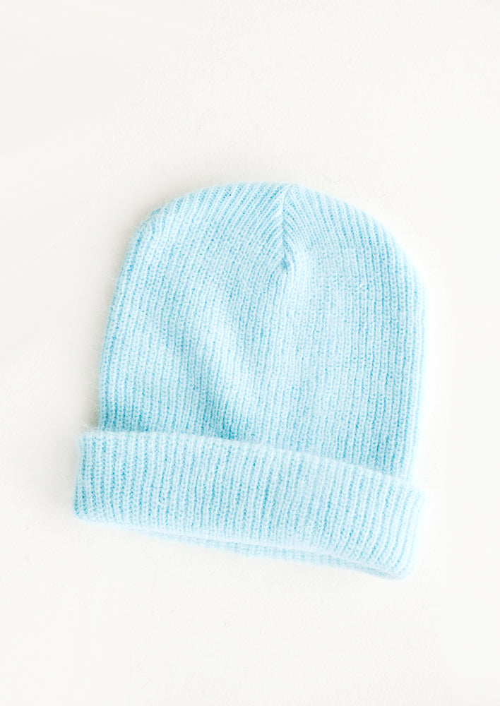 Light blue knit beanie with fold.