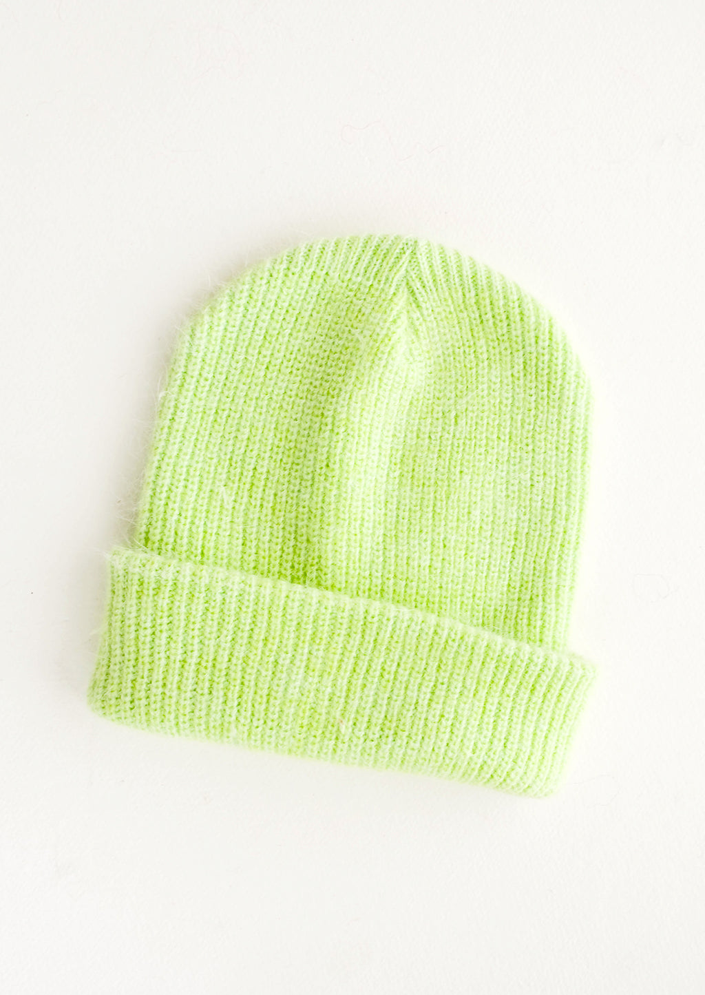 Lime: Lime green knit beanie with fold.